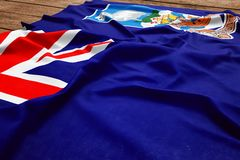 Flag of Falkland Islands on a wooden desk background. Silk flag top view.  stock photography