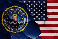 Flag of FBI and USA painted on cracked wall. A flag of FBI and USA painted on cracked wall Royalty Free Stock Images