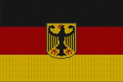 Flag and federal coat of arms of Germany on a vector knitted woolen texture. Knitted German flag and emblem creates seamless pattern Stock Photo