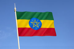 Flag of the Federal Democratic Republic of Ethiopia. Adopted after the defeat of Ethiopias Marxist Derg regime (in power from 1974–1991). The emblem is Royalty Free Stock Photo