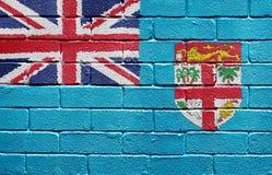 Flag of Fiji on brick wall. Flag of Fiji painted onto a grunge brick wall Stock Photography