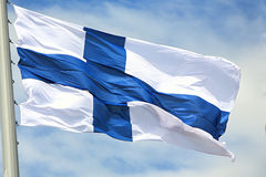 Flag of Finland. Against the sky Royalty Free Stock Photos