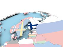 Flag of Finland on bright globe. Finland on political globe with embedded flags. 3D illustration Stock Image