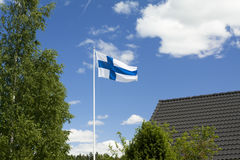 Flag of Finland on sky background. Flag of Finland on blue sky background Royalty Free Stock Photo