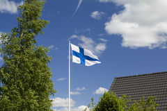 Flag of Finland on sky background. Royalty Free Stock Photos