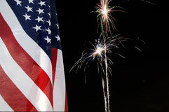 Flag and Fireworks. United States flag with fireworks in the background Stock Photo