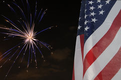 Flag and Fireworks. United States flag with fireworks in the background Stock Images