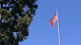 American Flag. The flag flapping in the wind at Huntington Gardens Royalty Free Stock Photography