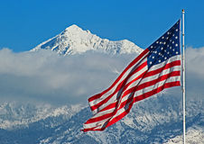 Flag Flies Above Snowy Utah Mountain Stock Image