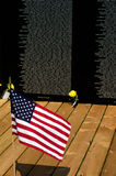 Flag and flowers honoring our fallen soldiers Royalty Free Stock Photo