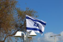 Flag fluttering in the wind. Israeli flag with a six-pointed star fluttering in the wind royalty free stock images