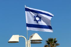 Flag fluttering in the wind. Israeli flag with a six-pointed star fluttering in the wind royalty free stock image