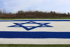 Flag fluttering in the wind. Israeli flag with a six-pointed star fluttering in the wind stock image