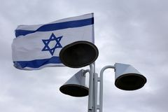 Flag fluttering in the wind. Israeli flag with a six-pointed star fluttering in the wind royalty free stock photography