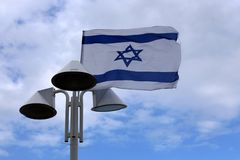 Flag fluttering in the wind. Israeli flag with a six-pointed star fluttering in the wind royalty free stock photos