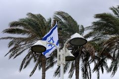 Flag fluttering in the wind. Israeli flag with a six-pointed star fluttering in the wind stock photography
