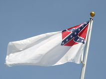 Flag flying. Civil war flag of the confederate states. Stars and bars on a white flag Stock Photo