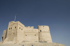 Flag flying over Fujairah Fort Stock Photo