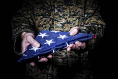 Flag fold old glory. American army soldier with flag fold old glory Stock Photography