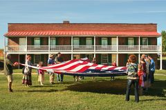 Flag folding at Fort McHenry National Monument in Baltimore, Maryland. Visitors to the Fort McHenry National Monument may participate in folding an enormous flag Stock Photo