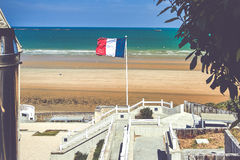 Flag Francais floats. On the beach of Avranches in Normandy, French Stock Image
