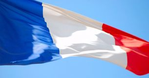 Flag of France. Against blue sky Stock Photos