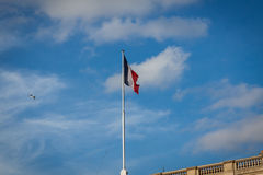 Flag of France fluttering under a serene blue sky Royalty Free Stock Photography