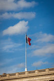 Flag of France fluttering under a serene blue sky Royalty Free Stock Photo