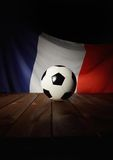 Flag of France with football on wooden boards. Stock Image
