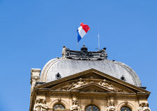 Flag of France over historic building. Royalty Free Stock Photo
