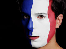 Flag of France. Painted on a Face of a Young Man Stock Photos