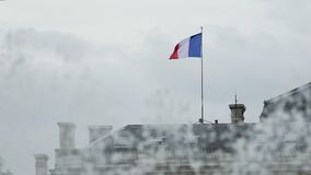 Flag of France standing on the roof of building and waving in the wind, fountain. Stock footage stock footage