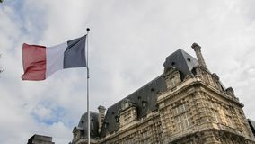 Flag of France waving in the wind against the blue sky. The concept of patriotism. Slow Motion.  stock footage