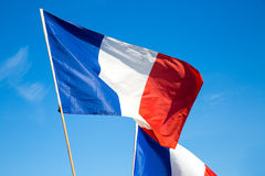 Flag of France, waving in the wind, on the sky royalty free stock image