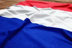Flag of France on a wooden desk background. Silk French flag top view.  royalty free stock photos
