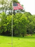 Flag of Freedom. This is the American flag flying one summers day out in the country Stock Images