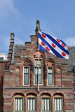 Flag of Friesland. Frisian Flag at the former Post Office in Leeuwarden, Capital of province Friesland in The Netherlands Stock Images