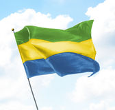 Flag of Gabon. Raised Up in The Sky Stock Photography