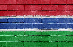 Flag of Gambia on brick wall stock photos