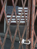 Flag and gate. Flag, locked up behind gate. Metaphor for homeland security, border policy, etc Royalty Free Stock Image