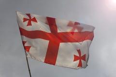 Flag of Georgia on a bamboo flagpole. In the sun Stock Photo