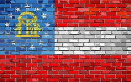 Flag of Georgia on a brick wall Stock Images