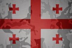 Flag of georgia on the khaki texture . military concept. Flag of georgia on the khaki texture background. military concept Stock Photo