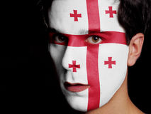 Flag of Georgia. Painted on a Face of a Young Man Royalty Free Stock Photo