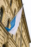 Flag of German state Bayern / Bavaria. Flag of German state Bayern on the pole at the facade of the building. Bavaria officially the Free State of Bavaria is a stock photos