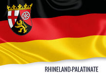 Flag of German state Rhineland-Palatinate waving on an isolated white background. Stock Images