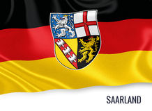 Flag of German state Saarland waving on an isolated white background. Royalty Free Stock Photography