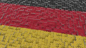 Flag of Germany being made with jigsaw puzzle pieces. German problem solution conceptual 3D rendering. Flag made of puzzle pieces, conceptual 3D stock illustration