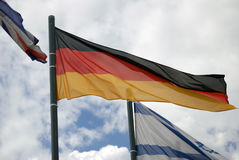 Flag of Germany, blue sky with clouds background Royalty Free Stock Photos