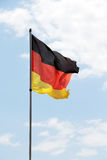 Flag of germany. A close up view of a flag of germany, against a bright sky, portrait cut Stock Image